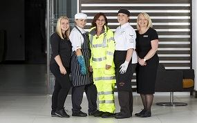 Female Compass staff get specially-designed PPE